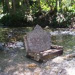 adirondik chairs nestled in the river