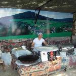 Turkish lady cooking pancakes in beach bar