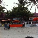 the beach bar Which is next to the hotel. chaweng garden beach resort is at the right hand side
