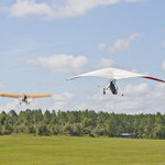 The ultralight airplane tows us up to the cloud base at 2500 feet.