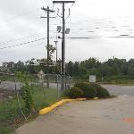 Railroad tracks adjacent hotel entrance.