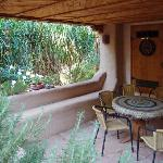 Covered area off garden is perfect for reading or a snack