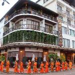 hotel with monks passing