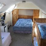 The room toilet to right of camera, double bed ahead, single to the left and bunkbeds to the rig