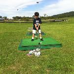 hitting balls at the driving range