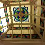 beautiful stained glass ceiling in the center of the stairwells ..guestrooms surround this..