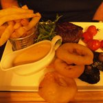 Steak, chips, pepper sauce and onion rings