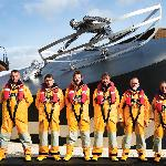 RNLI crew pictured in front of the Memorial (L to R - Garry Gibbs, David Steenvoorden, Kenneth P