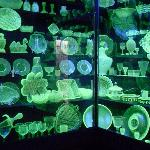 Huge collection of Vaseline glass under black lights.