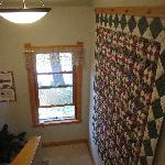 Beautiful quilt hangs in Garden house stairwell