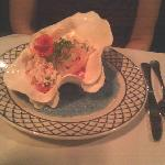 Shrimp salad served in a shell. Yum and pretty.