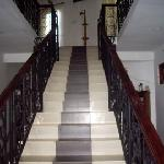 the stairs to the second floor and balcony
