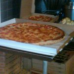 The massive pizza is a 28 inch $40 pizzazilla. the one next to it is a large pizza