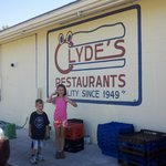 Two of my kids in front of the Clyde's sign.
