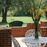 The Butler's Suite has private outdoor patio at ground level leading to the backyard and gardens