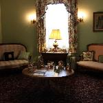Gather with other guests in one of two sitting rooms.