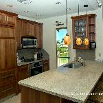 Fully Equipped Kitchen with Breakfast Bar and Access to Golf View Lanai