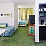 Each of our suites features a spacious living area with large sectional sofa and pantry area tha