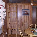 As you walk into the cabin.  Dining table and ladder to loft
