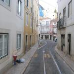 streets of alfama the tram passes