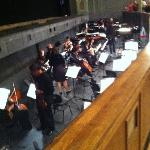 The Orchestra pit.  The conductor is visible thru out the performance which is entertainment in