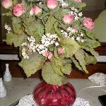 roses in cranberry glass