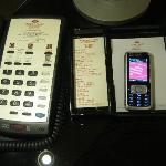 Mobile phone connected to room phone