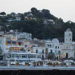 view of Lacco Ameno from the port.  La Sirenella is the yellow painted building with blue awning