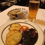 Reindeer steak with reduction sauce and roasted potato & tomato with draft Finnish lager