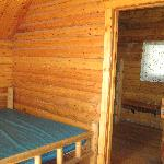 bed in front room of 2 room cabin