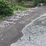 Fishing boats in the black beach