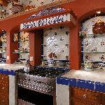 Custom-made Mexican tiles decorate the cocina