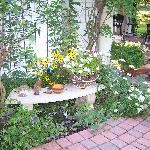 Gardens surround the home and guests enjoy breakfast on the patio on nice days