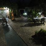 The courtyard at night charming setting for dinner!