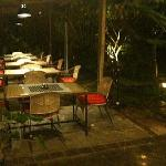 tables and garden area by night