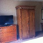 TV, closet and vanity area