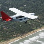 Our Airvan flying South along the West coast near Kalutara