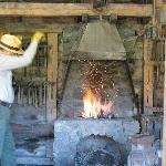 Ranger/tour guide demonstrating blacksmithing