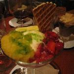 Olive Oil icecream with strawberries and basil syrup