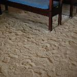 The sandy floor is a sephardic tradition dating back to the times of the Spanish Inquisition.