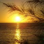 coucher de soleil plage devant l'hôtel