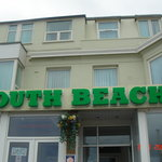 South Beach Frontage light up South Beach sign.