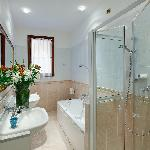 bathroom with shower and separate whirpool bath