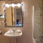 A clean but small bath room.