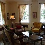 The spacious sitting room overlooks the village park