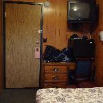 The tv, fridge and desk