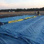 The balloon laid out on the ground just waiting to be inflated