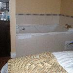 Spa tub adjacent to bed