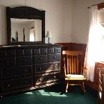 Dresser, Table and chairs in room