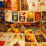 Local Laotian paintings for sale at a market stall
